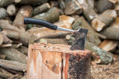 Hatchet in Stump. With firewood Stock Images