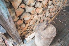Hatchet thrusted in old stump. Royalty Free Stock Photo