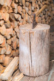 Hatchet thrusted in old stump. Stock Images