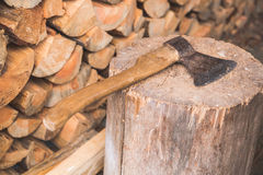 Hatchet thrusted in old stump. Stock Photography
