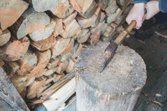 Hatchet thrusted in old stump. Royalty Free Stock Images
