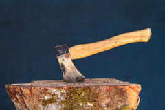 Hatchet in wood block Royalty Free Stock Photography