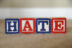 Hate. The word hate spelled out with toy blocks Stock Images