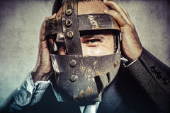 Hate, dangerous business man with iron mask and expressions Stock Image