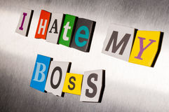 Hate My Boss written with color magazine letter clippings on metal background. Design for business relationship and work Stock Image