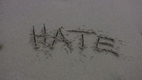 HATE' Washed Away on the Beach stock video footage