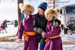 Free Hatgal, Mongolia, Febrary 25, 2018: Three Mogolian Boys Wear Traditional Clothes And Smiling In The Winter Forest Stock Photography - 156732642