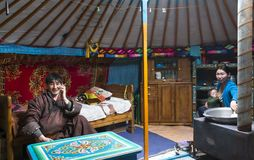 Young mongolian nomad family in their home ger yurt stock image