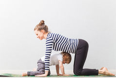 Hatha yoga fitness mother with baby home. Hatha yoga fitness mother with baby Royalty Free Stock Photo