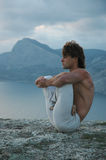 Hatha-yoga: padmasana. Man doing a padmasana - lotus posture (variant Stock Photos