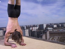 Hatha yoga on the roof Royalty Free Stock Photography