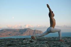 Hatha-yoga: virabhadrasana. Man doing a virabhadrasana (variant Stock Photo