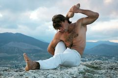 Hathayoga: eka-pada-shirshasana Stock Photography