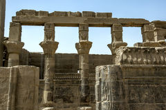 The Hathor capitals on the papyrus columns in the Temple of Nectanebo on Philae in Egypt. Stock Images