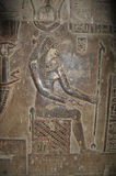 Hathor Temple. Beautiful bas-relief of the bare chested love goddess hathor enthroned in the crypt in her ancient Egyptian fertility and love temple at Dendera Stock Photos