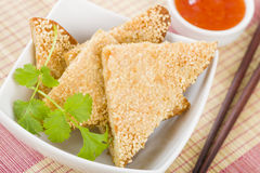 Hatosi (Prawn Toast). Chinese toasted bread with minced shrimp and sesame seeds served with sweet chili sauce Stock Photo