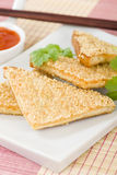 Hatosi (Prawn Toast). Chinese toasted bread with minced shrimp and sesame seeds served with sweet chili sauce Stock Photography