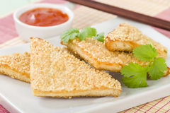 Hatosi (Prawn Toast). Chinese toasted bread with minced shrimp and sesame seeds served with sweet chili sauce Stock Photos