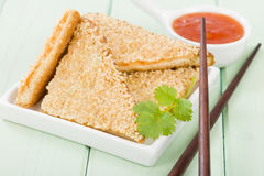Hatosi (Prawn Toast). Chinese toasted bread with minced shrimp and sesame seeds served with sweet chili sauce Royalty Free Stock Image