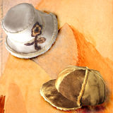 Hats 14. Italian hats on painted background Royalty Free Stock Photos