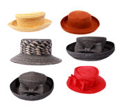 Hats. Six summer straw hats in white stock images