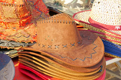 Hats. Cowboy hats on the market for sale royalty free stock image
