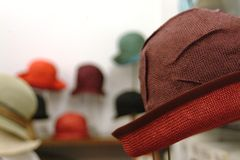 Hats. Red hat in the shop Stock Image