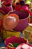 Hats and Baskets. At a French street market Royalty Free Stock Photo