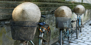 Hats on bicycle. 3 bicycle and 3 hats, near at temple in hue , Vietnam stock images
