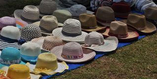 Hats and bonnets for sale near the beach Royalty Free Stock Photography