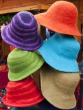 Hats in bright colors. Funny felt hats in several different colors royalty free stock photo