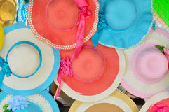 Hats brightly colored. People lined up waiting to buy Royalty Free Stock Image