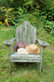 Hats on chair outdoors Royalty Free Stock Photo