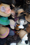 Hats in a display window in Paris Royalty Free Stock Image