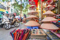 Hats in front of the shop in Hanoi stock photography