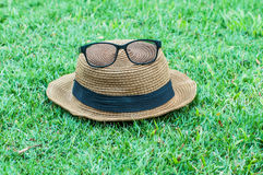 Hats glasses on grass Stock Image