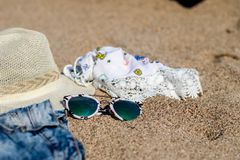 Hats and glasses placed on the beach. Summer royalty free stock photography