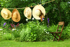 Hats hanging on clothesline