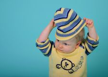 Hats off!. Baby taking off his hat stock images