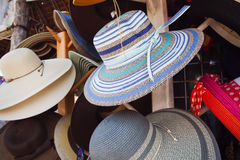 Hats on a rack Stock Images