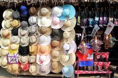 Hats for Sale. Colorful hats and souvenirs for sale at souvenir shop stock photo