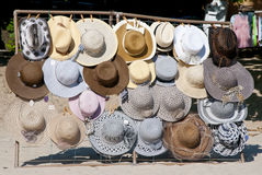 Hats for sale. Display of various hats for sale on Trinidade beach in Rio de Janeiro, Brazil stock photography