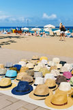 Hats on sale at La Barceloneta beach in Barcelona, Spain Royalty Free Stock Photo