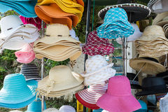 Hats for sale. A selection of colourful sun hats for sale at the beach front Stock Image
