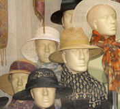 Hats shop. Window aspect with different mannequins wearing heats Royalty Free Stock Photo