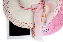 Hats and tablet ready for summer. on white background. Hats and iPad ready for summer. on white background Royalty Free Stock Images
