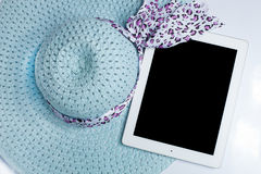 Hats and tablet ready for summer. on white background. Hats and iPad ready for summer. on white background Royalty Free Stock Image