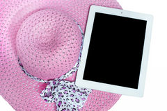 Hats and tablet ready for summer. on white background. Hats and iPad ready for summer. on white background Royalty Free Stock Photo