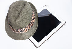 Hats and tablet ready for summer. on white background. Hats and iPad ready for summer. on white background Royalty Free Stock Photos