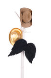 Hats and wings on a rack Royalty Free Stock Images